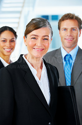 Buy stock photo Business team and a leader - Mature business woman with his colleagues in the background