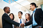 Mixed race business people shaking hands
