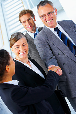 Buy stock photo Handshake and teamwork. Two businesspeople shaking hands in a light and modern office.