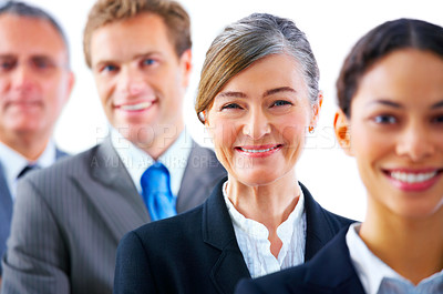 Buy stock photo Young business woman - Mature business man with his colleagues in the background