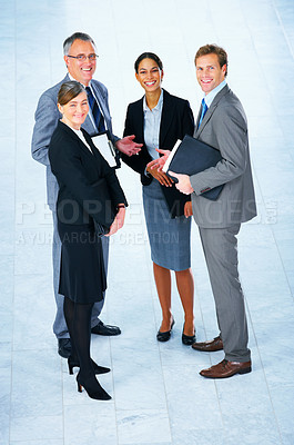 Buy stock photo Business partners standing in a light and modern office setting