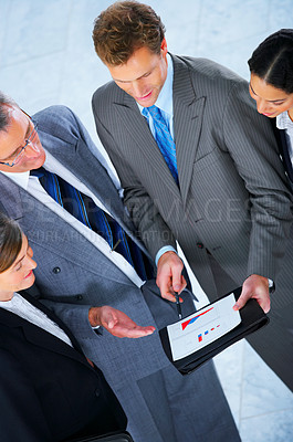Buy stock photo Business team talking business - Business team at a meeting in a light and modern office setting.