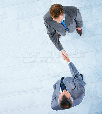Buy stock photo Business handshake and trust taken from above, with lots of copyspace to the left