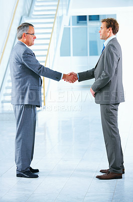 Buy stock photo Business handshake and trust. Two businessmen shanking hands in a light and modern office.