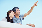 Smiling couple - Man pointing up at  copyspace