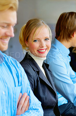 Buy stock photo A smiling young female in a cafe surrounded by her friends. This could be a workplace, college or business setting.