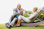 Beautiful couple toasting wine glasses outdoors
