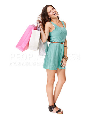 Buy stock photo Studio shot of young woman carrying shopping bags against a white background