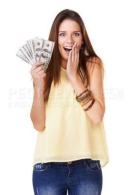 Buy stock photo Studio shot of an excited young woman  holding up fanned out banknotes isolated on white