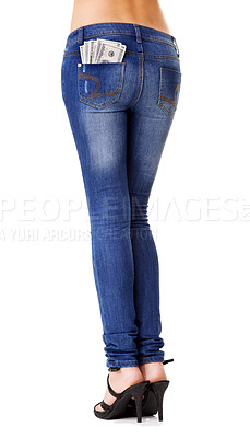 Buy stock photo Waist-down studio shot of a woman wearing tight jeans with money poking out of the back pocket