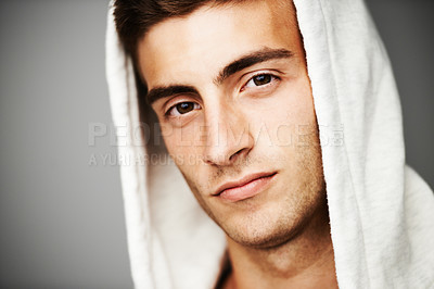 Buy stock photo Close up portrait of a good looking male with a hoodie on