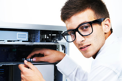 Buy stock photo A hipster technician working on an electronical appliance
