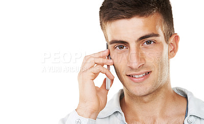 Buy stock photo A handsome male talking on his cell phone with a white background