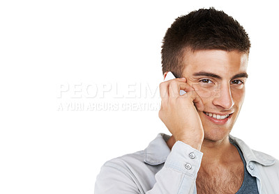 Buy stock photo A smiling male talking on his cellphone with copy space