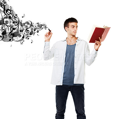 Buy stock photo A man reading a book while music notes flow from his pen
