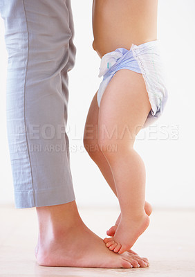 Buy stock photo Cropped close up shot of a mother playfully teaching her baby how to walk