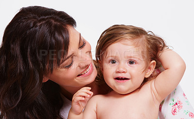 Buy stock photo Close up studio shot of a mother holding her baby isolated on white