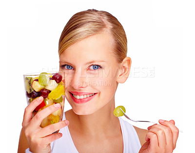 Buy stock photo A young woman enjoying a healthy fruit salad