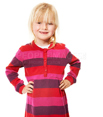 Buy stock photo A cute little blonde girl smiling while standing with her hands on her hips