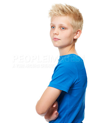 Buy stock photo Cropped studio shot of a blond teenage boy standing against a white background