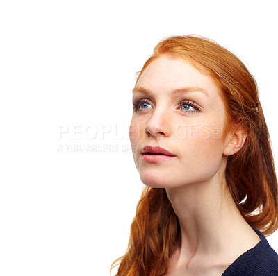 Buy stock photo Studio shot of an attractive redhead isolated on white