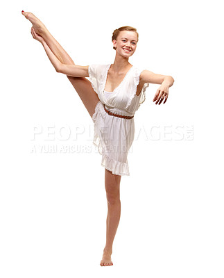 Buy stock photo Full length shot of a gorgeous young woman in an elegant ballet pose on a white background