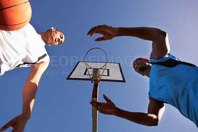 Buy stock photo A basketball palyer hogging the ball