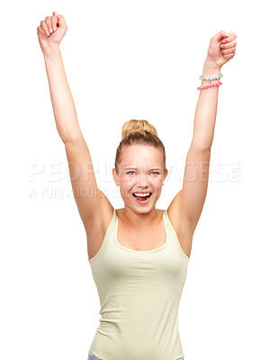 Buy stock photo A pretty woman standing with arms raised in the air in a joyful gesture