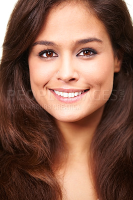 Buy stock photo Studio portrait of a beautiful smiling brunette