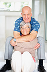 Romantic happy senior man embracing his pretty wife at home