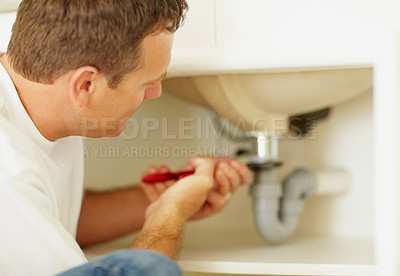 Plumber fixing a problem in the sink