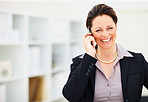 Happy mature business woman speaking on cellphone