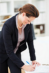 Business woman filling a sheet of paper