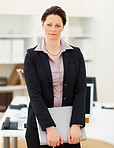 Mature business woman holding a folder at the office