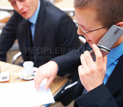 Buy stock photo Closeup of a business man using cellphone in a meeting