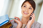 Beautiful young female with shopping bags speaking on the phone