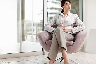 Buy stock photo Young business woman sitting on a chair , waiting for someone
