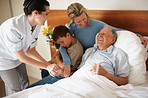 Happy senior patient being visited by family at the hospital