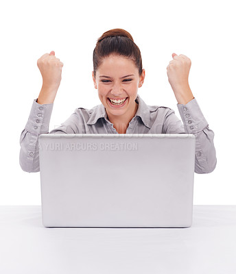 Buy stock photo Shot of a ecstatic-looking young woman seated in front of a laptop isolated on white