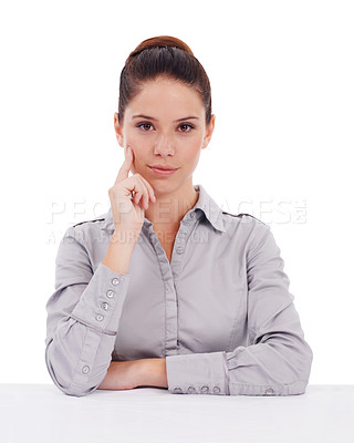 Buy stock photo Studio portrait of a stern-looking young businesswoman isolated on white