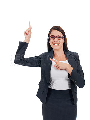 Buy stock photo Studio portrait of a confident-looking young business woman pointing upwards isolated on white
