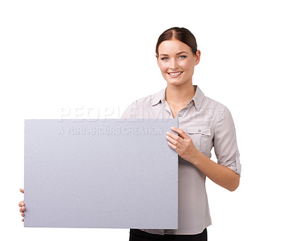 Buy stock photo Cropped shot of an attractive young woman holding a blank sign isolated on white