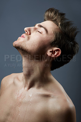 Buy stock photo Cropped shot of a handsome young man posing in the studio