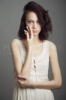 Buy stock photo Portrait of a beautiful young woman wearing vintage clothing and posing with hand on her cheek