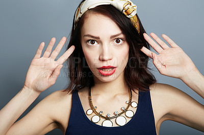 Buy stock photo Portrait of a beautiful young woman posing with hands in the air and a shocked expression on her face