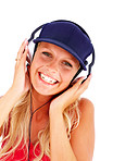 Happy young female hearing music on the headphones on white