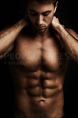Buy stock photo Muscular young man isolated on black