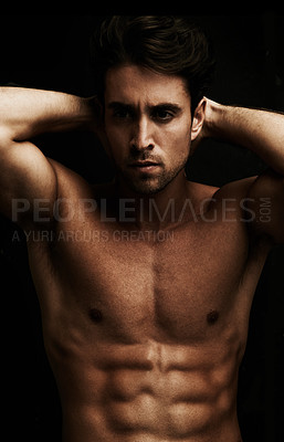 Buy stock photo Goodlooking young man showing off his six pack