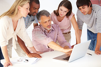 Buy stock photo Shot of a diverse group of colleagues in the office