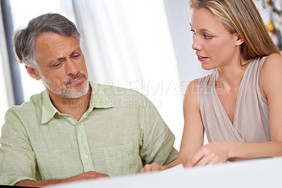 Buy stock photo Two designers having a meeting
